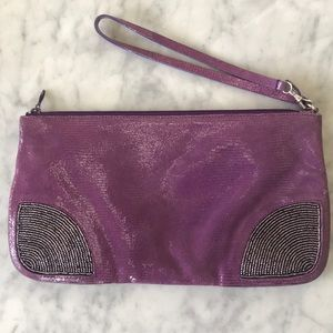 BCBG lizard embossed clutch with beading detail